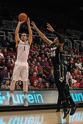 Stanford guard Christian Sanders (1) shoots over Colorado guard Josh Fortune during the first half of an NCAA college basketball game in Stanford, Calif., Sunday, Jan. 3, 2016. Colorado won 56-55. (AP Photo/Jason O. Watson)