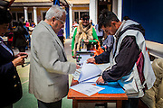 A man goes to the pre-register on the voting site to discover the location of the designated voting table in the Ecuador school in central La Paz. On Sunday, 12th October, President Evo Morales was re-elected for a third term by a majority of 60% and will turn into the longest serving President of the country if he finishes is mandate in 2020.