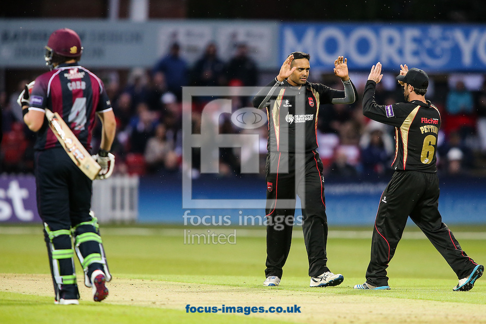 Jigar Naik of Leicestershire Foxes (centre) celebrates with Mark Pettini of Leicestershire Foxes (right) after taking the wicket of Josh Cobb of Northants Steelbacks (left) during the Natwest T20 Blast match at Grace Road, Leicester<br /> Picture by Andy Kearns/Focus Images Ltd 0781 864 4264<br /> 20/05/2016