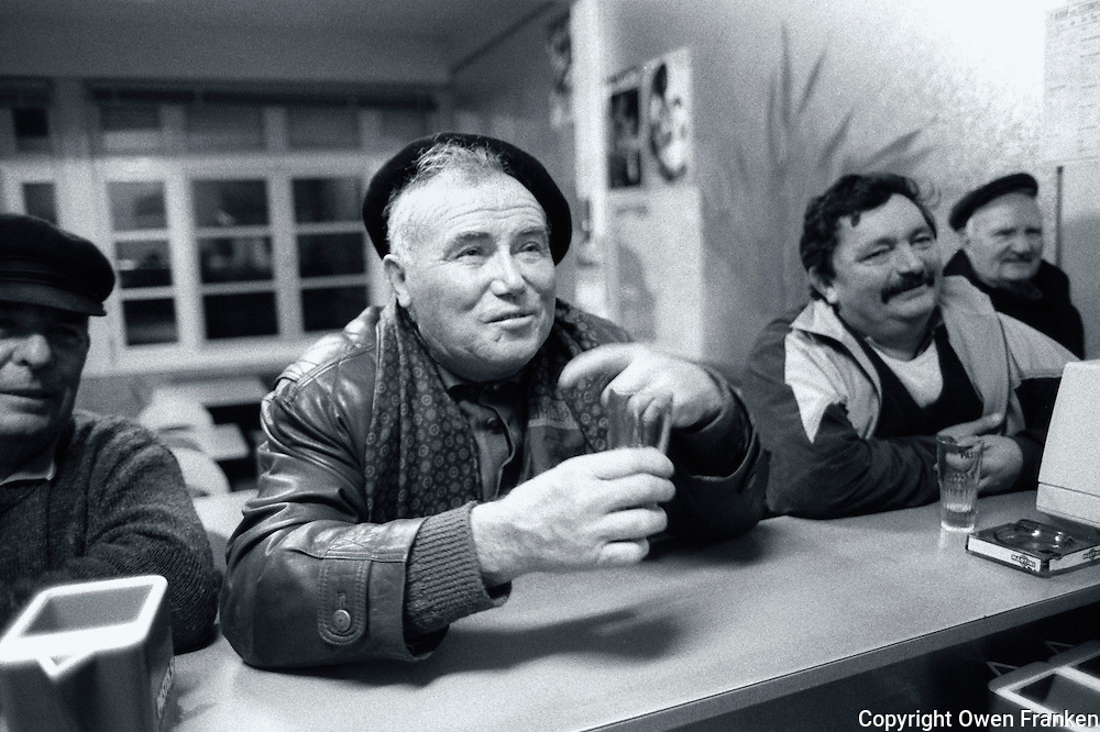 drinkers at a rural French bar