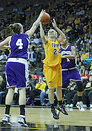 December 30, 2011: Iowa Hawkeyes guard Jaime Printy (24) puts up a shot as Northwestern Wildcats forward Kendall Hackney (4) defends during the NCAA women's basketball game between the Northwestern Wildcats and the Iowa Hawkeyes at Carver-Hawkeye Arena in Iowa City, Iowa on Wednesday, December 30, 2011.