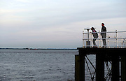 17 July 2014: TA couple using a telescope on Hull  Pier, East Yorkshire, UK.<br /> Picture: Sean Spencer/Hull News &amp; Pictures Ltd<br /> 01482 772651/07976 433960<br /> www.hullnews.co.uk   sean@hullnews.co.uk