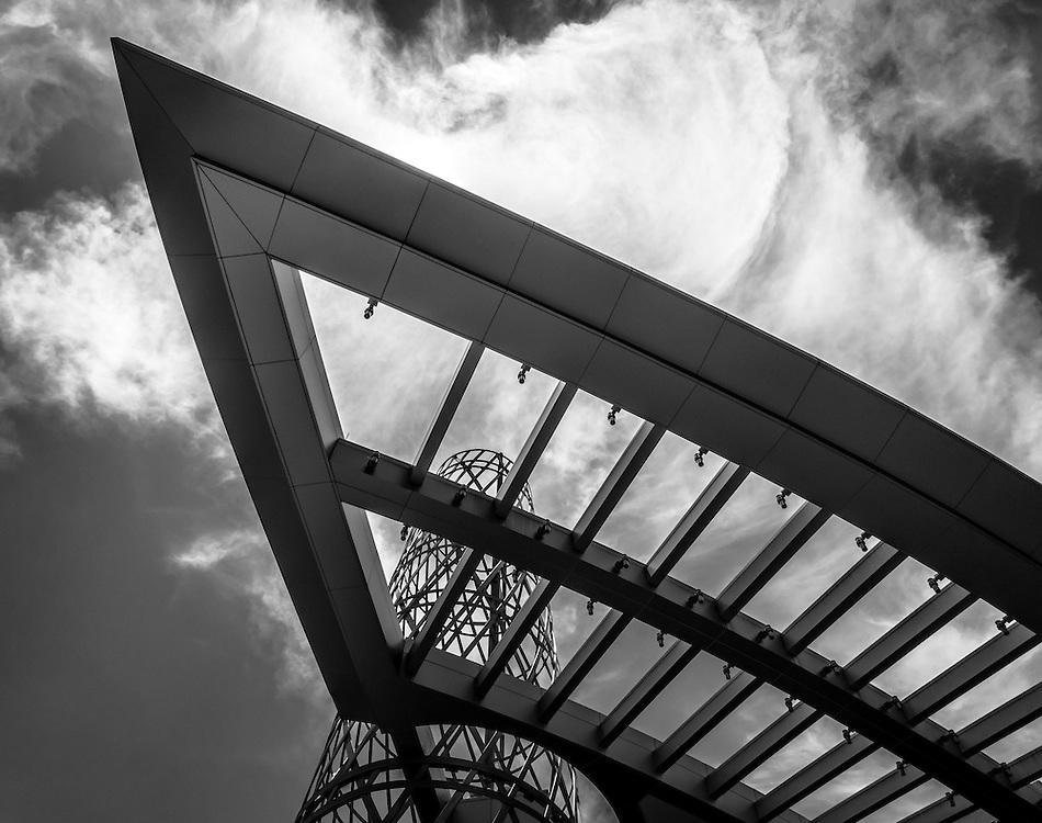 Part of the newly redesigned Student Union at N.C. State University, this ground up view of the Technology Tower and the adjacent architectural awning like structure, creates a striking silhouette against the dramatic clouds above.