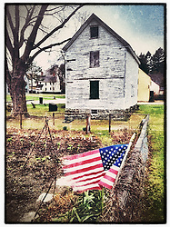 "An American flag at the Victory Garden at Strawbery Banke Museum in Portsmouth, New Hampshire. iPhone photo - suitable for print reproduction up to 8"" x 12""."