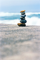 Rocks balanced one atop the other on beach (focus on rocks)