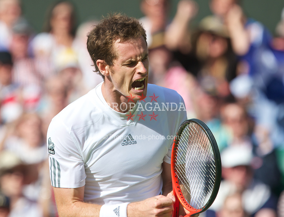 LONDON, ENGLAND - Monday, July 1, 2013: Andy Murray (GBR) celebrates after winning the second set in a tie-break during the Gentlemen's Singles 4th Round match on day seven of the Wimbledon Lawn Tennis Championships at the All England Lawn Tennis and Croquet Club. (Pic by David Rawcliffe/Propaganda)
