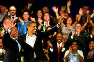 "October 16, 2010 - Governor Deval Patrick (right) and President Barack Obama (left) wave to the crowd at a campaign rally for the reelection of Patrick, which was held at the Hynes Convention Center in Boston on Saturday. ""When Deval speaks I listen,"" Obama said. Adding later, ""it's not just about the work we've done, it's about the work we got left to do."" Photo by Lathan Goumas."