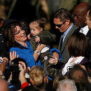 Vice Presidential candidate Sarah Palin holds up a baby with Down Syndrome at the end of her campaign rally in Pasco County at Sims Park in New Port Richey.