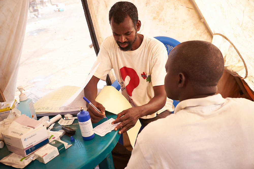 HIV activist Boubacar Alpha Diallo tests a man for HIV at the MSF mobile clinic in the neighbourhood of Tombolia, Conakry, Guinea on March 18, 2016. The man in is an imam from the local mosque and explains that he has been faithful to his wife since they have been married. He is relieved when his results show he is HIV negative. Bouboucar encourages the man to ask his wife to be tested also to be completely sure they are both HIV negative. MSF launched a HIV testing campaign in Conakry with the support of health authorities moving throughout several neighbourhoods throughout 2016.<br /> <br /> Despite countries in West and Central Africa having a relatively low HIV prevalence (