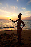 Girl holding sun, Sunset, Kaanapali Beach, Maui, Hawaii