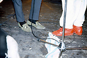 The Mint Juleps' shoes at a gig, UK. 1980s.