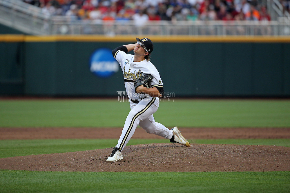 Carson Fulmer #15 of the Vanderbilt Commodores pitches during Game 2 of the 2014 Men's College World Series between the Vanderbilt Commodores and Louisville Cardinals at TD Ameritrade Park on June 14, 2014 in Omaha, Nebraska. (Brace Hemmelgarn)