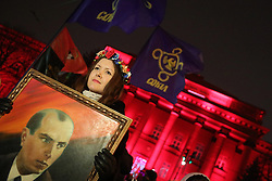 January 1, 2018 - Kyiv, Ukraine - A young woman holds the portrait of OUN leader Stepan Bandera outside the red building of the Taras Shevchenko National University of Kyiv at the start of a torchlight procession marking 109 years since Bandera's birth, Kyiv, capital of Ukraine, January 1, 2018. Ukrinform...KYIV. Members of the public have marked the 109th birthday anniversary of Stepan Bandera, the leader of the Organisation of Ukrainian Nationalists (OUN). Traditionally, they marched along the central streets lighting their way with torches. (Credit Image: © Yevhen Liubimov/Ukrinform via ZUMA Wire)