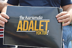 August 16, 2017 - Ankara, Turkey - A man shows a placard that reads 'There is no justice in this council' as anti-government demonstrators gathered in front of the Supreme Election Council (YSK) to protest against unsealed ballot papers in the voting for the Turkish constitutional referendum in Ankara, Turkey on August 16, 2017. The referendum was held on April 16 as the demonstrators chant the slogan 'We still search for justice' in the fourth month after historic voting. (Credit Image: © Altan Gocher/NurPhoto via ZUMA Press)