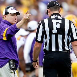November 25, 2011; Baton Rouge, LA, USA;  LSU Tigers head coach Les Miles talks to an official during the third quarter of a game against the Arkansas Razorbacks at Tiger Stadium. LSU defeated Arkansas 41-17. Mandatory Credit: Derick E. Hingle-US PRESSWIRE
