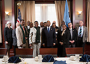 Ohio University representatives including President Roderick McDavis, center, and members of the Ministry of Education Skills and Development, Botswana, pose for a group portrait before a luncheon at Baker Center on January 21, 2014. The luncheon was hosted by the Ohio University Center for International Studies. <br /> (Individual names, if needed:<br /> FRONT: Dr. Moses Mengwe, Mrs. Grace Muzila, President Roderick McDavis, Ms. Beatrice Selotlegeng<br /> MIDDLE: Dr. Lorna Jean Edmonds, Dr. Hugh Sherman, Dr. Poloko Chepete,  Mr. Labane Earl Mokgosi, Ms. Emolemo Morake, Dr. Scott Seaman<br /> BACK: Master Barongwa Baipidi, Dr. Renée Middleton, Dr. Robert Frank,  Jeremiah Asaka, Dr. Steve Howard)