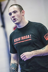 Stef Noij, KMG Instructor from the Institute Krav Maga Netherlands, talks during the IKMS G Level Programme seminar today at the Scottish Martial Arts Centre, Alloa.