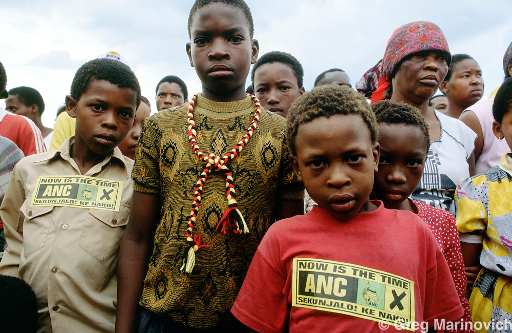 South Africa , 1994. People in  ANC regalia attend an election rally on Sharpeville Day 21 March 1994