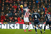 Leeds United defender Liam Cooper (6) wins a header during the EFL Sky Bet Championship match between Stoke City and Leeds United at the Bet365 Stadium, Stoke-on-Trent, England on 19 January 2019.