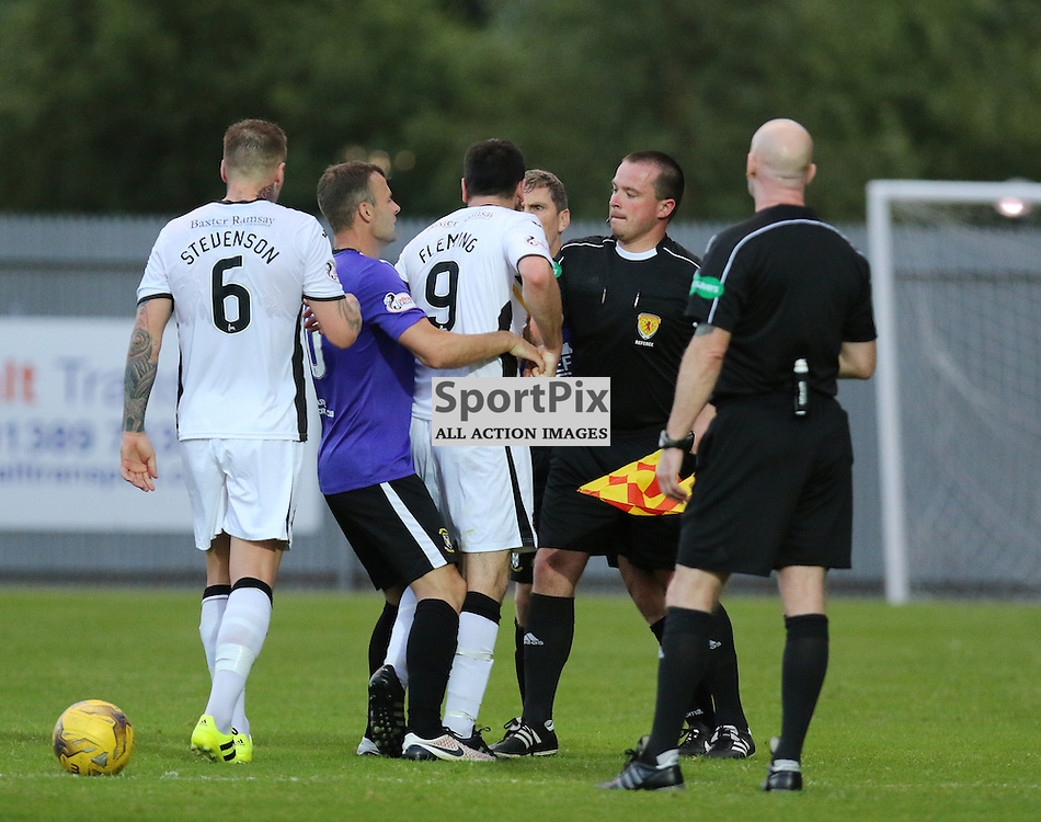 Kevin Smith has to hold Garry Fleming back during the Dumbarton v East Fife Scottish League Cup group stage 19 July 2016<br /> <br /> (c) Andy Scott | SportPix.org.uk