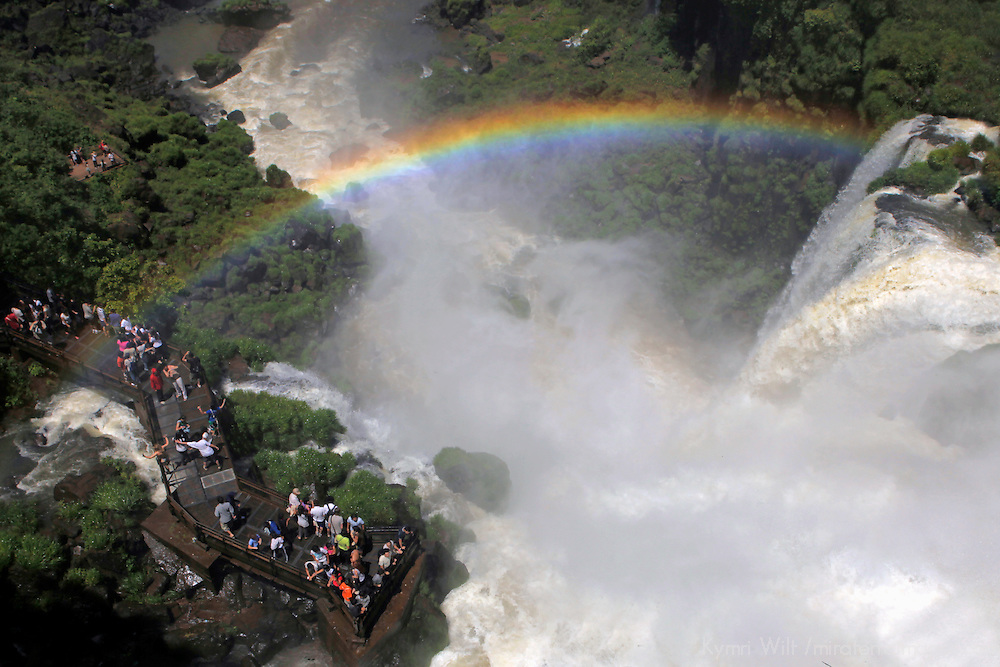 South America, Argentina, Iguacu Falls. Rainbow over visitors at Iguacu Falls.