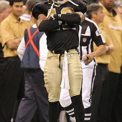 Jan 24, 2010; New Orleans, LA, USA; New Orleans Saints safety Darren Sharper (42) celebrates after a defensive stop during a 31-28 overtime victory by the New Orleans Saints over the Minnesota Vikings in the 2010 NFC Championship game at the Louisiana Superdome. Mandatory Credit: Derick E. Hingle-US PRESSWIRE