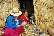 Native Uro Lady, Uros Floating Islands, Lake Titicaca, Puno Region, Peru