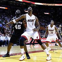 17 January 2012:  Miami Heat power forward Chris Bosh (1) vies with San Antonio Spurs forward DeJuan Blair (45) during the Miami Heat 120-98 victory over the San Antonio Spurs at the AmericanAirlines Arena, Miami, Florida, USA.