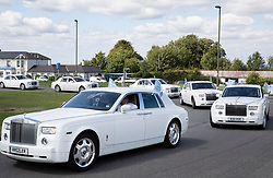 © Licensed to London News Pictures. 21/08/2018. Epsom, UK. Some of the 16 Rolls Royce Phantom cars carry mourners to the funeral of traveller Mikey Connors for his burial at a nearby cemetery. 32 year-old Mikey Connors, the nephew of My Big Fat Gypsy Wedding star Paddy Doherty, was killed when his horse-and-cart was hit by a car in Thamesmead on July 28. Photo credit: Peter Macdiarmid/LNP