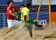 07 December 2006, Brazil's Andre Nascimento slides the ball past England's goalkeeper Gareth Vaughan Icke during the first game of the Vodacom Pro Beach Soccer Tour at Durban's Bay of Plenty on Thursday. Brazil won the game 10 - 3. Picture: Shayne Robinson, PhotoWire Africa