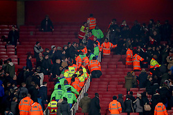 19 December 2017 -  EFL Cup (1/4 Final) - Arsenal v West Ham United - Stewards try to separate the 2 sets of fans as they approach each other at full time - Photo: Marc Atkins/Offside