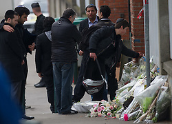 """People lay flowers to show respect at The """"Ozar Hatorah"""" Jewish school  on March 20, 2012 in Toulouse, southwestern France. The bodies of three French-Israeli children and a Jewish teacher killed in a gun attack began their journey Tuesday from the school where they died to their burial in Israel..The bodies were due to be flown from Paris Charles de Gaulle airport later Tuesday for a funeral in Israel. Photo by i-Images"""