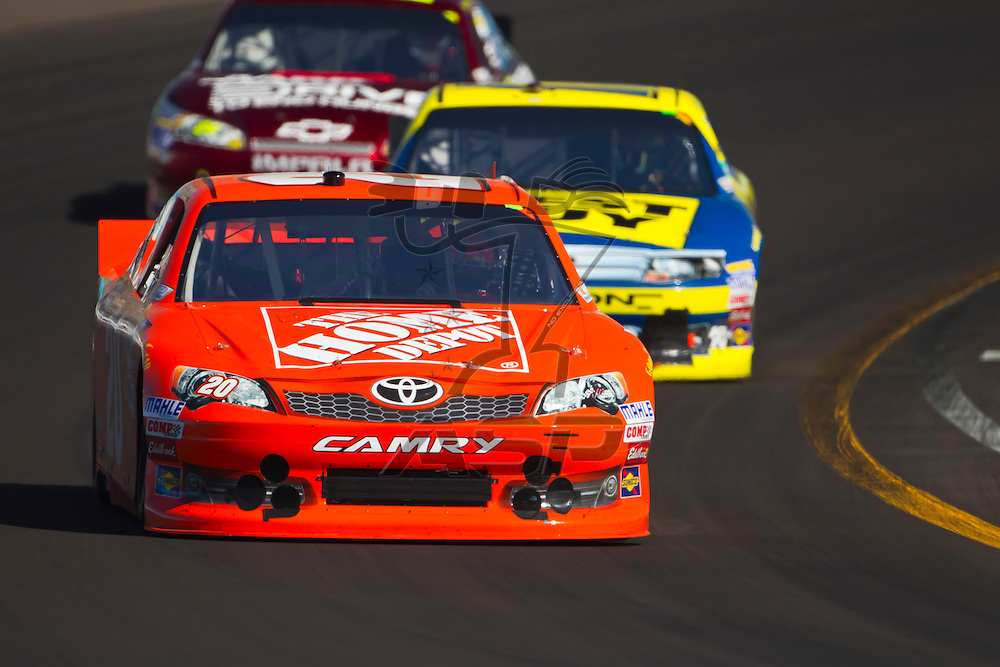 AVONDALE, AZ - MAR 04, 2012:  Joey Logano (20) brings his car through turn 1 during the Subway Fresh Fit 500 race at the Phoenix International Raceway in Avondale, AZ.