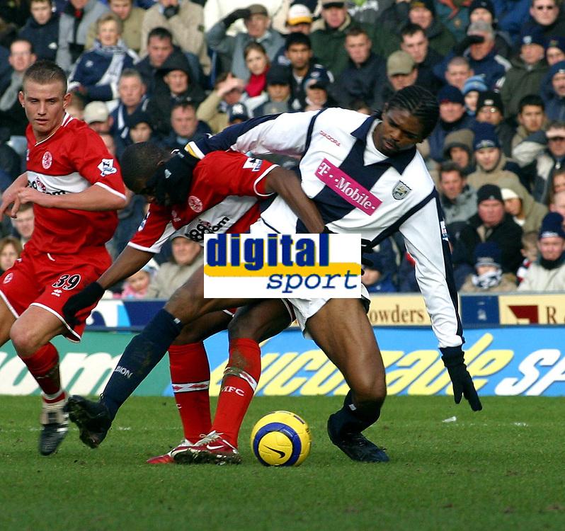 Photo: Dave Linney.<br />West Bromwich Albion v Middlesbrough. The Barclays Premiership. 26/02/2006.West Brom's Kanu(R) battles with   Aiyebeni Yakuba