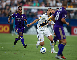 July 29, 2018 - Carson, California, U.S - Zlatan Ibrahimovic #9 of the LA Galaxy with the ball moves between defenders during their game with the Orlando City on Sunday July 29, 2018 at StubHub Center in Carson, California. LA Galaxy defeats Orlando City, 4-3. (Credit Image: © Prensa Internacional via ZUMA Wire)