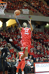 17 February 2013:  Jackie Carmichael lays the ball up on the glass as he passes the basket during an NCAA Missouri Valley Conference mens basketball game where the Shockers of Wichita State played the Illinois State Redbirds  in Redbird Arena, Normal IL