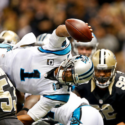Dec 7, 2014; New Orleans, LA, USA; Carolina Panthers quarterback Cam Newton (1) jumps over the line for a touchdown against the New Orleans Saints during the first quarter of a game at the Mercedes-Benz Superdome. Mandatory Credit: Derick E. Hingle-USA TODAY Sports