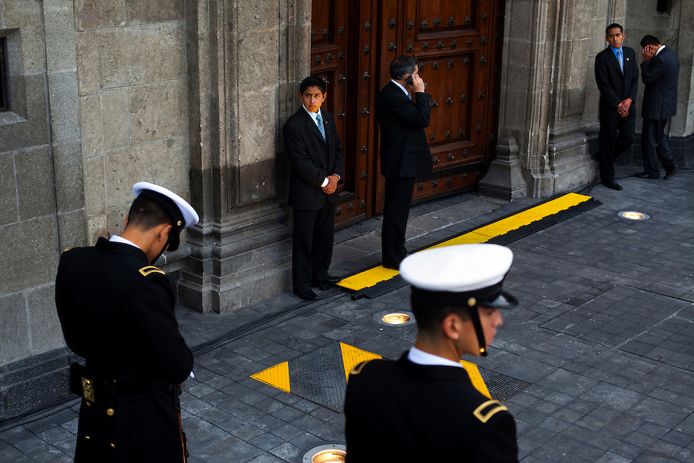 Bodyguards patrol outside the presidential palace just before a parade for Mexico's bicentennial celebration, in Mexico City to mark the 200th anniversary of the uprising against Spanish rule which eventually led to their declaration of independence in 1821.