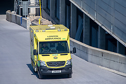 © Licensed to London News Pictures. 26/03/2020. London, UK. A London ambulance arrives at the ExCeL London exhibition centre. The huge exhibition centre in London is to be used as a field hospital during the COVID-19 coronavirus pandemic. Photo credit: Peter Manning/LNP