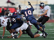 A Roosevelt Defender attempts to block a field goal attempt by Wagner, Season finale, matches up Roosevelt Rough Riders vs. Wagner Thunderbirds, 10 November 2007, Comalander Stadium, San Antonio, TX, Texas High School Football , Roosevelt 37, Wagner 25.