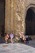 Cellist busker on the Placa de Catedral, Jaca, Huesca, Aragon, Spain