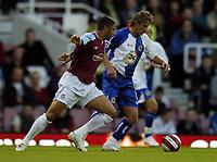Photo: Olly Greenwood.<br />West Ham United v Blackburn Rovers. The Barclays Premiership. 29/10/2006. Blackburn's Tugay and West Ham's Hayden Mullins