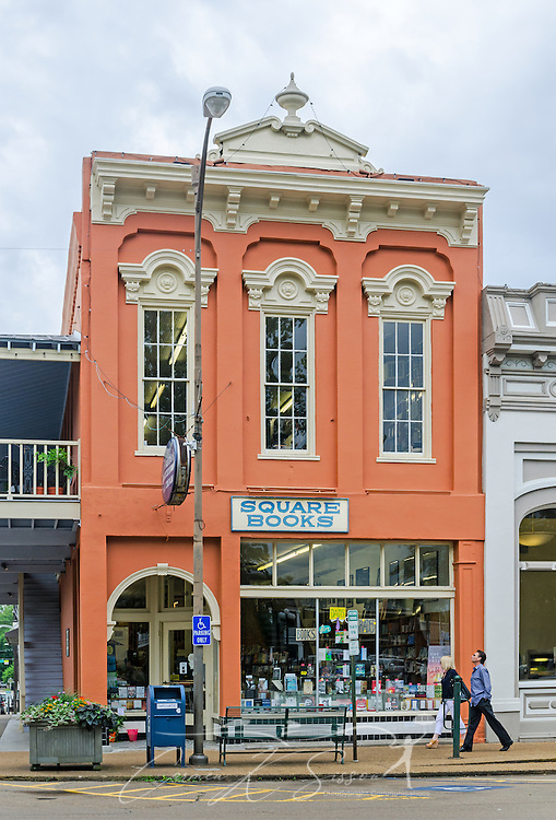 A couple walks past Square Books, May 31, 2015, in Oxford, Mississippi. The family-owned bookstore was founded in 1979 by Richard and Lisa Howorth and is considered to be one of the catalysts prompting downtown revitalization in Courthouse Square. (Photo by Carmen K. Sisson/Cloudybright)