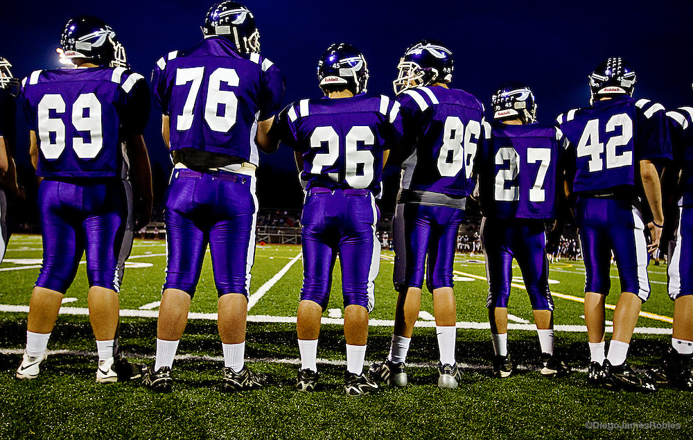 Waiting to get back into the game, a section of the Chieftain offense watches the action from the sidelines.