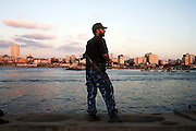 A Hamas security force member stands watch over the Gaza harbor August 05, 2007 in Gaza City, Gaza. Since taking control in a violent coup in June, Hamas has built a reputation of providing strong security within this long troubled Palestinian territory...