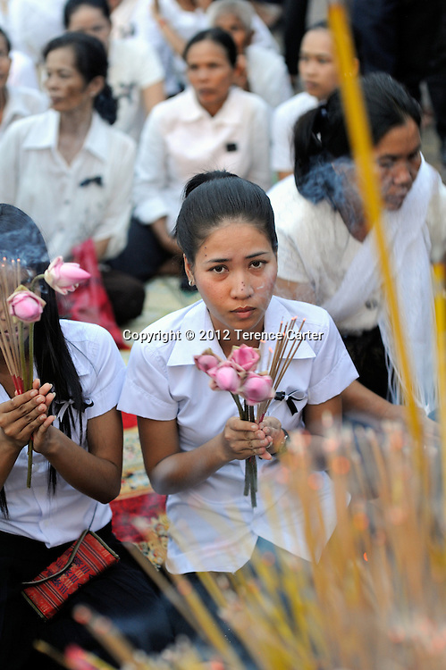 Mourners pay their respects after King Father Norodom Sihanouk's body is returned to the Royal Palace, Phnom Penh, starting a week of mourning in Cambodia.