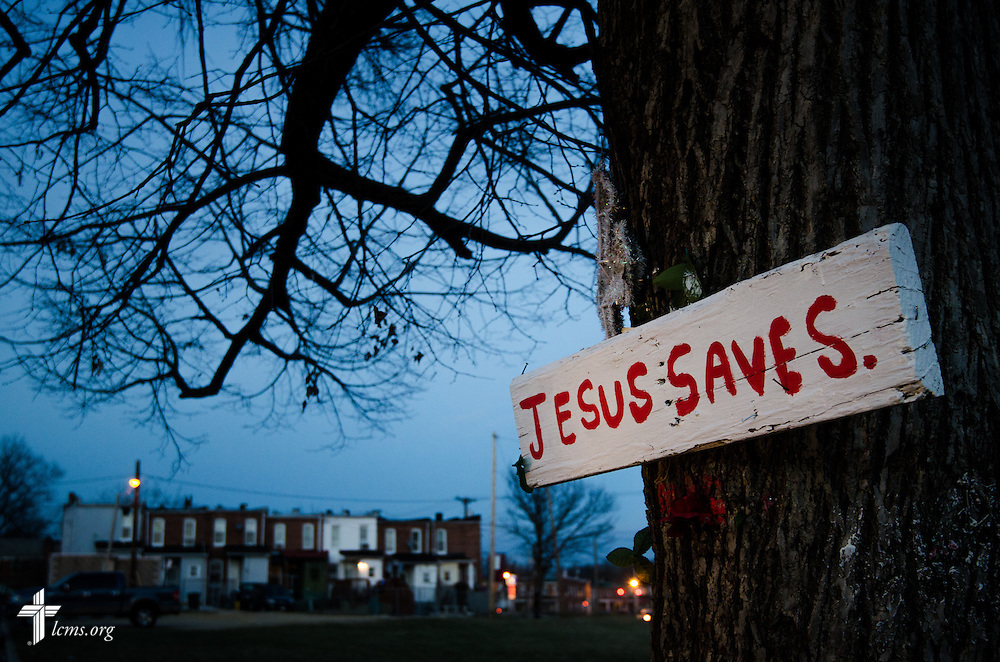 A sign nailed to a tree punctuates the dusk Thursday, March27, 2014, outside a neighborhood in Baltimore, Md. LCMS Communications/Erik M. Lunsford