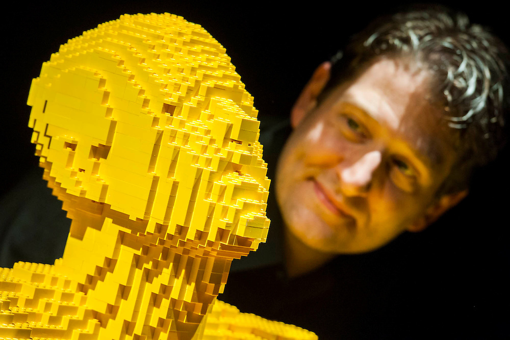 The Art of the Brick (in LEGO) by Nathan Sawaya (Pictured) -  over a million pieces of Lego® make up over 80 sculptures, including: replicas of artworks such as The Mona Lisa and Michelangelo's David; personal works in dedicated to 'The Human Condition'; a 'British' room full of exhibits created for London;'Dinosaur', the biggest of all the sculptures created from over 80,000 bricks; and 'Yellow'  (Pictured) which Lady Gaga recently commissioned for her G.U.Y. video.  The exhibition runs from 26 Sept 2014 to 04 Jan 2015. The Truman Brewery, Brick Lane, London, UK 24 Sept 2014