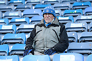 A fan in the Fratton End stand ahead of the EFL Sky Bet League 1 match between Portsmouth and Ipswich Town at Fratton Park, Portsmouth, England on 21 December 2019.
