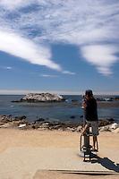 17 Mile Drive Boy Tourist Looking Through Telescope at Bird Rock, Pacific Grove, California